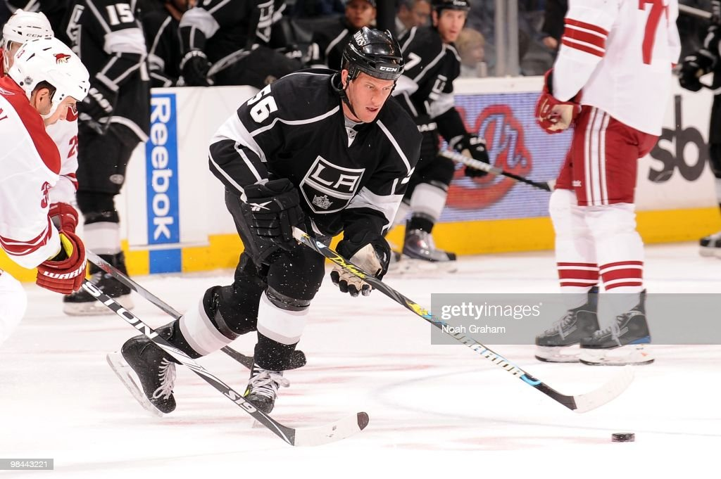 Rich Clune #56 of the Los Angeles Kings skates with the puck against the Phoenix Coyotes on April 8, 2010 at Staples Center in Los Angeles, California.