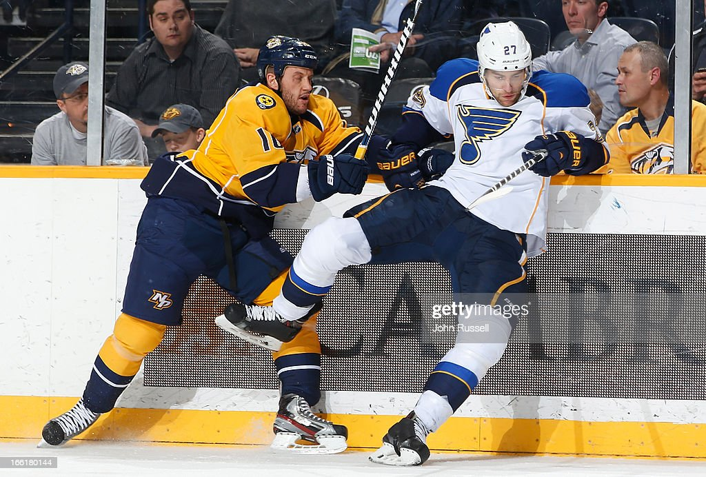 Rich Clune #16 of the Nashville Predators checks Alex Pietrangelo #27 of the St. Louis Blues during an NHL game at the Bridgestone Arena on April 9, 2013 in Nashville, Tennessee.