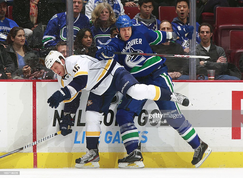 Rich Clune #16 of the Nashville Predators checks Andrew Alberts #41 of the Vancouver Canucks during their NHL game at Rogers Arena March 14, 2013 in Vancouver, British Columbia, Canada. Vancouver won 7-4.