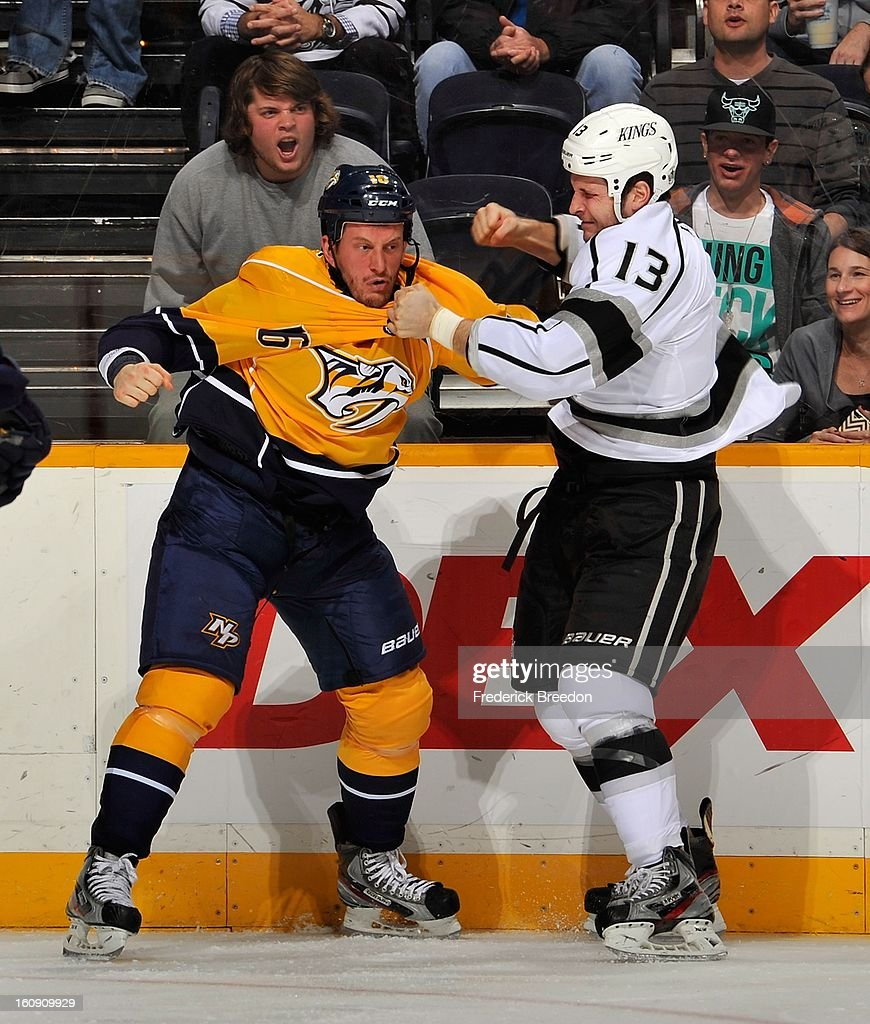Rich Clune #16 of the Nashville Predators fights Kyle Clifford #13 of the Los Angeles Kings at the Bridgestone Arena on February 7, 2013 in Nashville, Tennessee.