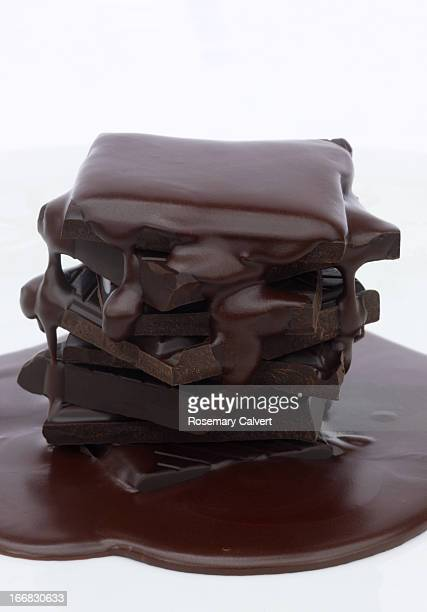 Rich dark chocolate stack with melted chocolate