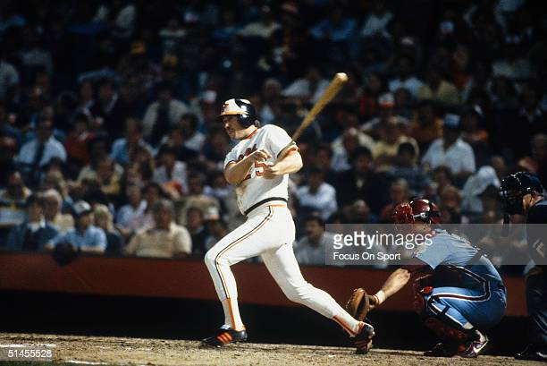 Rich Dauer of the Baltimore Orioles connects with the ball and runs for first against the Philadelphia Phillies during the World Series at Memorial...