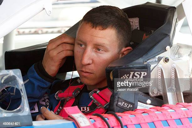 Rich DeLong III driver of the Country Girl Saloon/Ron's Rear Ends Chevrolet sits in his car during practice before the NASCAR KN Pro Series West...