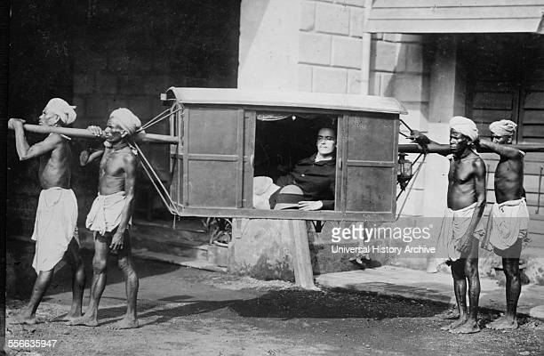 Rich English merchant carried in a palanquin India 1922
