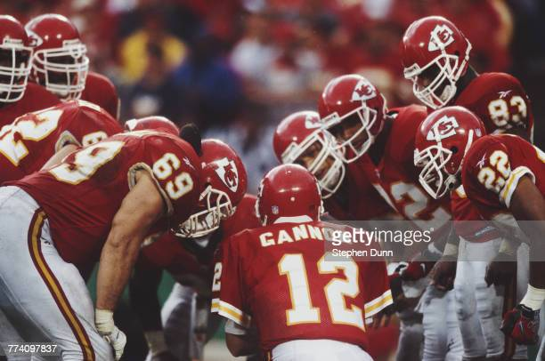 Rich Gannon Quarterback for the Kansas City Chiefs calls the play to his offensive line in the huddle during the American Football Conference West...