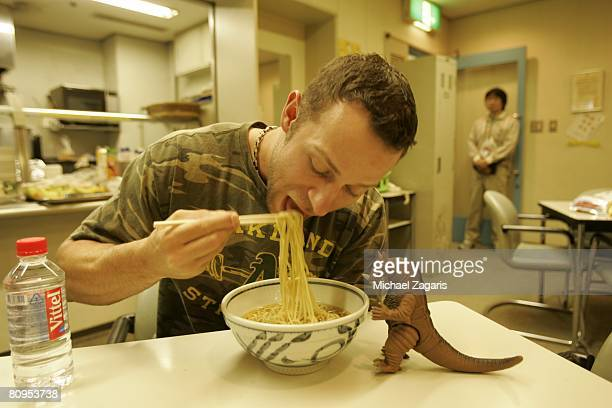 Rich Harden of the Oakland Athletics eats breakfast with Zebulon in the clubhouse before the MLB Opening Series against the Boston Red Sox at the...