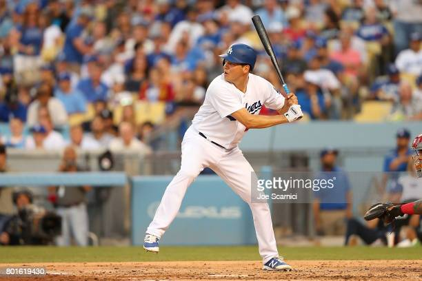 Rich Hill of the Los Angeles Dodgers at bat in the 2'nd inning against the Los Angeles Angels at Dodger Stadium on June 26 2017 in Los Angeles...