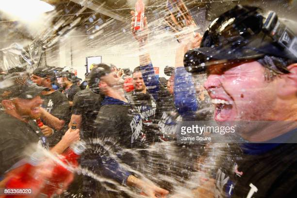 Rich Hill of the Los Angeles Dodgers celebrates in the clubhouse after defeating the Chicago Cubs 11-1 in game five of the National League...