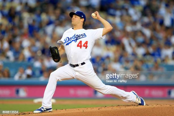 Rich Hill of the Los Angeles Dodgers delivers the pitch against the Arizona Diamondbacks in game two of the National League Division Series at Dodger...
