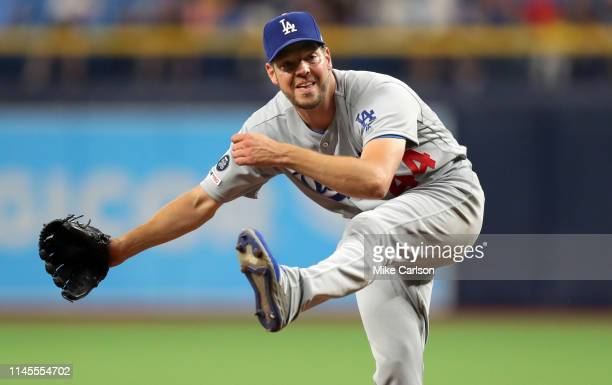 Rich Hill of the Los Angeles Dodgers follows through on a pitch in the third inning against the Tampa Bay Rays at Tropicana Field on May 22 2019 in...