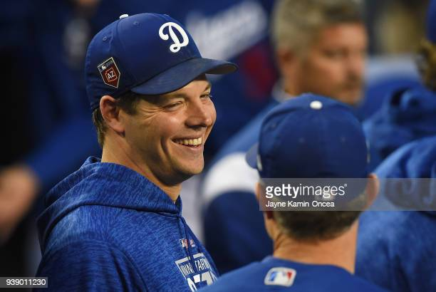 Rich Hill of the Los Angeles Dodgers in the dugout during the spring training game against the Los Angeles Angels of Anaheim at Dodger Stadium on...