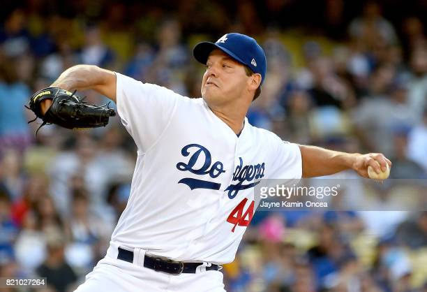 Rich Hill of the Los Angeles Dodgers in the first inning of the game against the Atlanta Braves at Dodger Stadium on July 22 2017 in Los Angeles...
