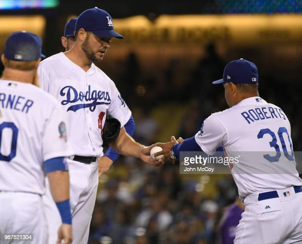 Rich Hill of the Los Angeles Dodgers is pulled from the game by Manager Dave Roberts in the seventh inning against the Colorado Rockies at Dodger...