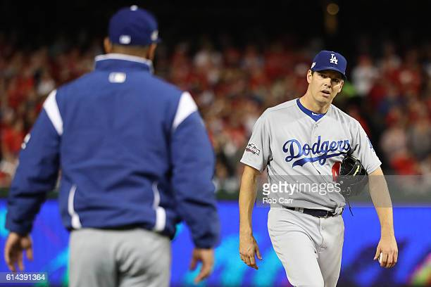 Rich Hill of the Los Angeles Dodgers is relieved from the game in the third inning against the Washington Nationals during game five of the National...