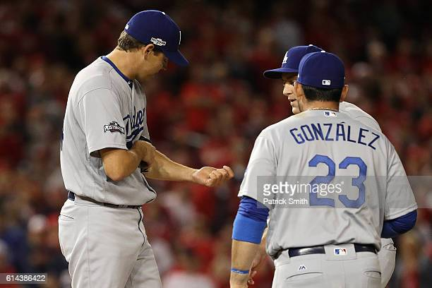Rich Hill of the Los Angeles Dodgers looks on after being hit by a ball against the Washington Nationals during game five of the National League...