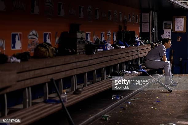 Rich Hill of the Los Angeles Dodgers looks on from the dugout after being pulled during the eighth inning despite pitching seven perfect innings...