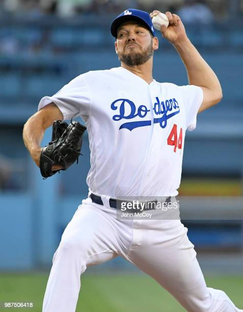 Rich Hill of the Los Angeles Dodgers on the mound against the Colorado Rockies in the first inning at Dodger Stadium on June 29 2018 in Los Angeles...