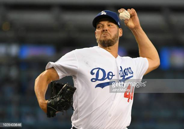 Rich Hill of the Los Angeles Dodgers pitches against the Arizona Diamondbacks int he first inining at Dodger Stadium on August 30 2018 in Los Angeles...