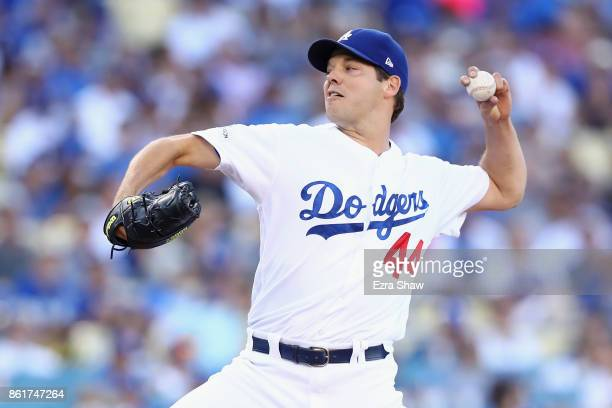 Rich Hill of the Los Angeles Dodgers pitches against the Chicago Cubs in the first inning during Game Two of the National League Championship Series...