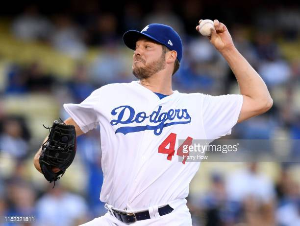 Rich Hill of the Los Angeles Dodgers pitches against the New York Mets during the first inning at Dodger Stadium on May 28 2019 in Los Angeles...
