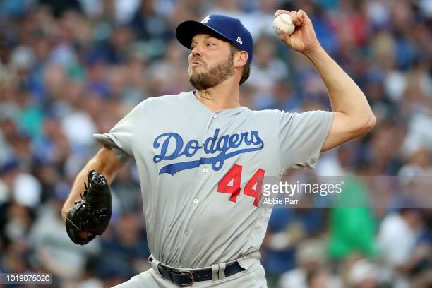 Rich Hill of the Los Angeles Dodgers pitches against the Seattle Mariners in the first inning during their game at Safeco Field on August 18 2018 in...
