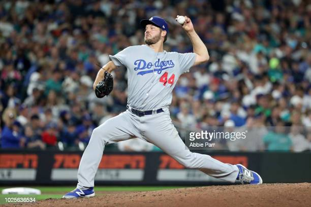 Rich Hill of the Los Angeles Dodgers pitches against the Seattle Mariners in the sixth inning during their game at Safeco Field on August 18 2018 in...