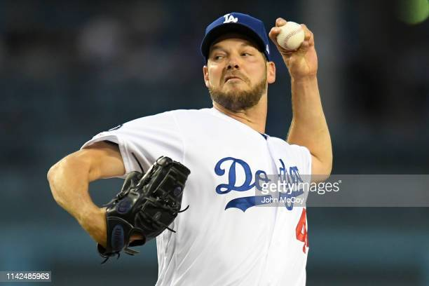 Rich Hill of the Los Angeles Dodgers pitches against the Washington Nationals in the first inning at Dodger Stadium on May 9 2019 in Los Angeles...