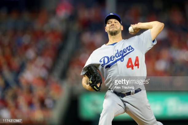 Rich Hill of the Los Angeles Dodgers pitches against the Washington Nationals during Game 4 of the NLDS between the Los Angeles Dodgers and the...