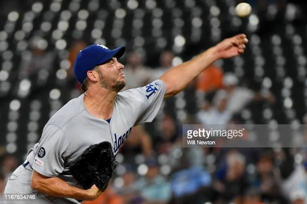 Rich Hill of the Los Angeles Dodgers pitches during the first inning against the Baltimore Orioles at Oriole Park at Camden Yards on September 12,...