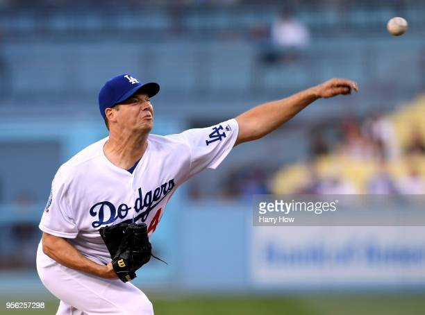 Rich Hill of the Los Angeles Dodgers pitches during the first inning against the Arizona Diamondbacks at Dodger Stadium on May 8 2018 in Los Angeles...