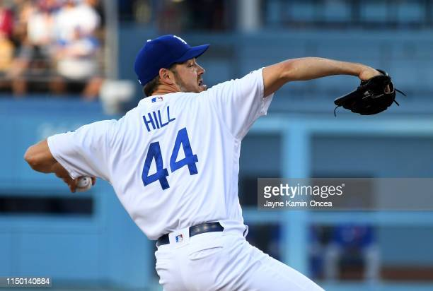 Rich Hill of the Los Angeles Dodgers pitches in the first inning of the game against the Chicago Cubs at Dodger Stadium on June 14 2019 in Los...