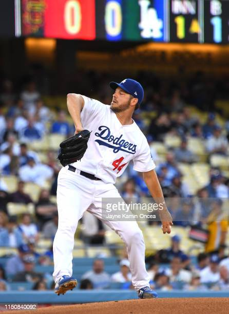 Rich Hill of the Los Angeles Dodgers pitches in the first inning of the game against the San Francisco Giants at Dodger Stadium on June 19 2019 in...