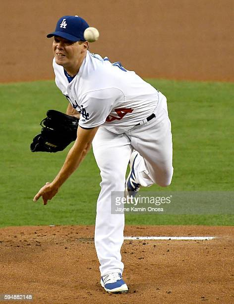 Rich Hill of the Los Angeles Dodgers pitches in the first inning of the game against the San Francisco Giants at Dodger Stadium on August 24 2016 in...