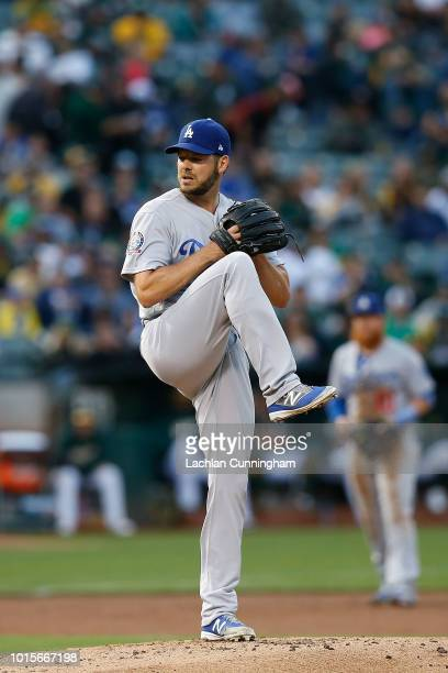 Rich Hill of the Los Angeles Dodgers pitches in the first inning against the Oakland Athletics at Oakland Alameda Coliseum on August 7 2018 in...