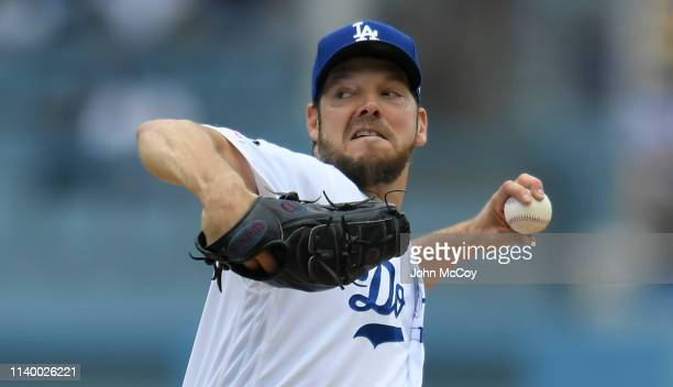 Rich Hill of the Los Angeles Dodgers pitches in the first inning agaisnt the Pittsburgh Pirates at Dodger Stadium on April 28 2019 in Los Angeles...