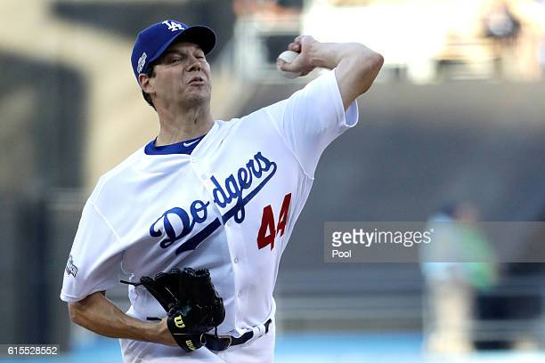 Rich Hill of the Los Angeles Dodgers pitches in the first inning against the Chicago Cubs in game three of the National League Championship Series at...