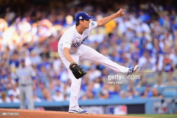 Rich Hill of the Los Angeles Dodgers pitches in the first inning against the Chicago Cubs during game two of the National League Championship Series...