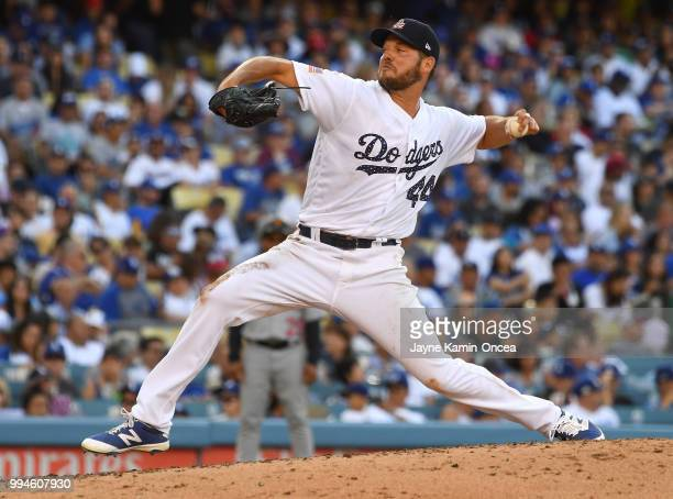 Rich Hill of the Los Angeles Dodgers pitches in the game against the Pittsburgh Pirates at Dodger Stadium on July 4 2018 in Los Angeles California