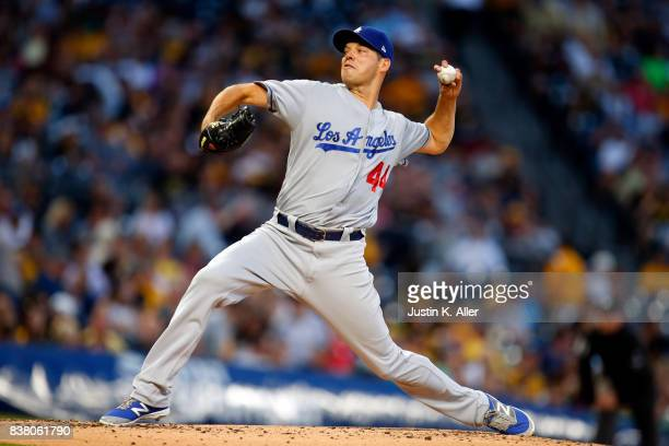 Rich Hill of the Los Angeles Dodgers pitches in the third inning against the Pittsburgh Pirates at PNC Park on August 23 2017 in Pittsburgh...
