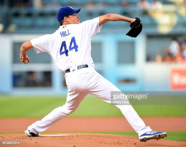 Rich Hill of the Los Angeles Dodgers pitches to the Arizona Diamondbacks during the first inning at Dodger Stadium on July 6 2017 in Los Angeles...