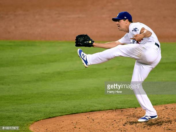 Rich Hill of the Los Angeles Dodgers pitches to the Arizona Diamondbacks during the fourth inning at Dodger Stadium on July 6 2017 in Los Angeles...