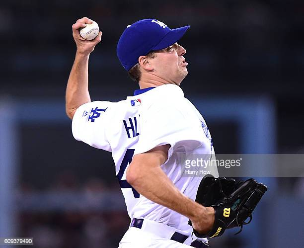 Rich Hill of the Los Angeles Dodgers pitches to the San Francisco Giants during the first inning at Dodger Stadium on September 20 2016 in Los...