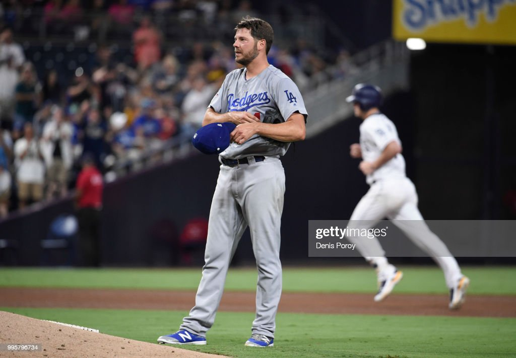Rich Hill #44 of the Los Angeles Dodgers reacts after giving up a solo home run to Wil Myers #4 of the San Diego Padres during the fifth inning of a baseball game at PETCO Park on July 10, 2018 in San Diego, California.
