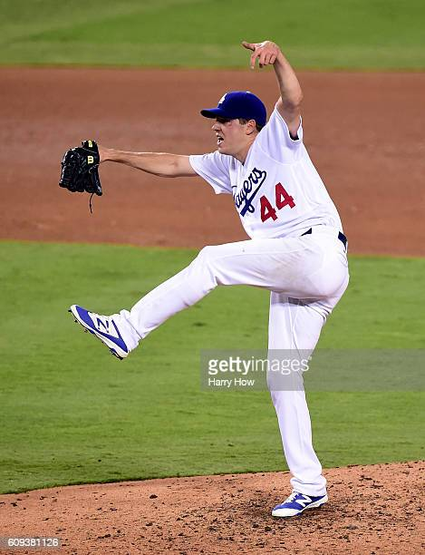 Rich Hill of the Los Angeles Dodgers reacts to his strikeout of Brandon Belt of the San Francisco Giants to end the top of the fourth inning at...