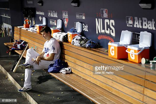 Rich Hill of the Los Angeles Dodgers sits in the dugout while taking on the Chicago Cubs in game three of the National League Championship Series at...