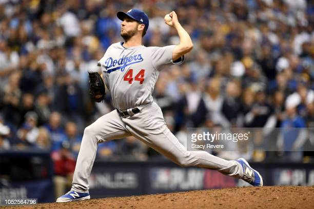 Rich Hill of the Los Angeles Dodgers throws a pitch against the Milwaukee Brewers during the eighth inning in Game Six of the National League...