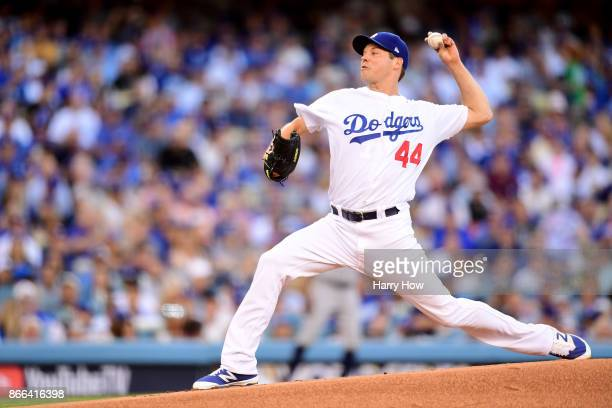 Rich Hill of the Los Angeles Dodgers throws a pitch during the first inning against the Houston Astros in game two of the 2017 World Series at Dodger...