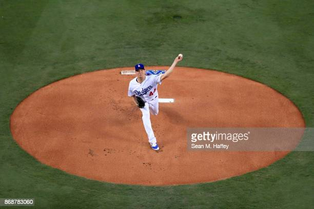 Rich Hill of the Los Angeles Dodgers throws a pitch during the first inning against the Houston Astros game six of the 2017 World Series at Dodger...