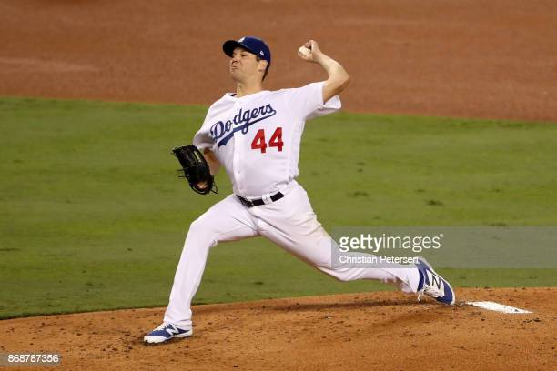 Rich Hill of the Los Angeles Dodgers throws a pitch during the third inning against the Houston Astros game six of the 2017 World Series at Dodger...