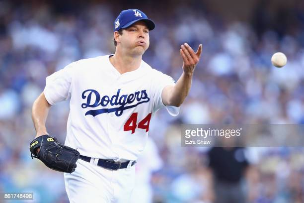 Rich Hill of the Los Angeles Dodgers throws the ball to first baseman Cody Bellinger of the Los Angeles Dodgers in the second inning during Game Two...